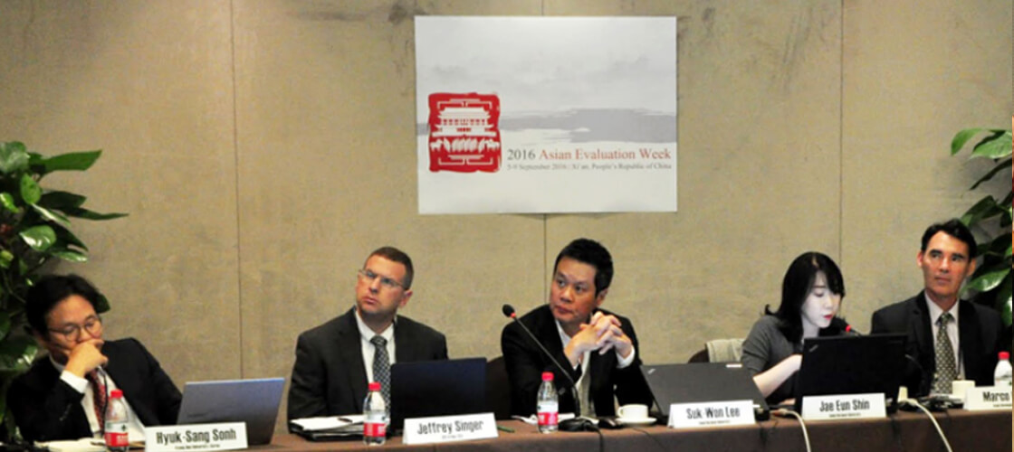 QED's President and CEO Presents at Asian Evaluation Week in China